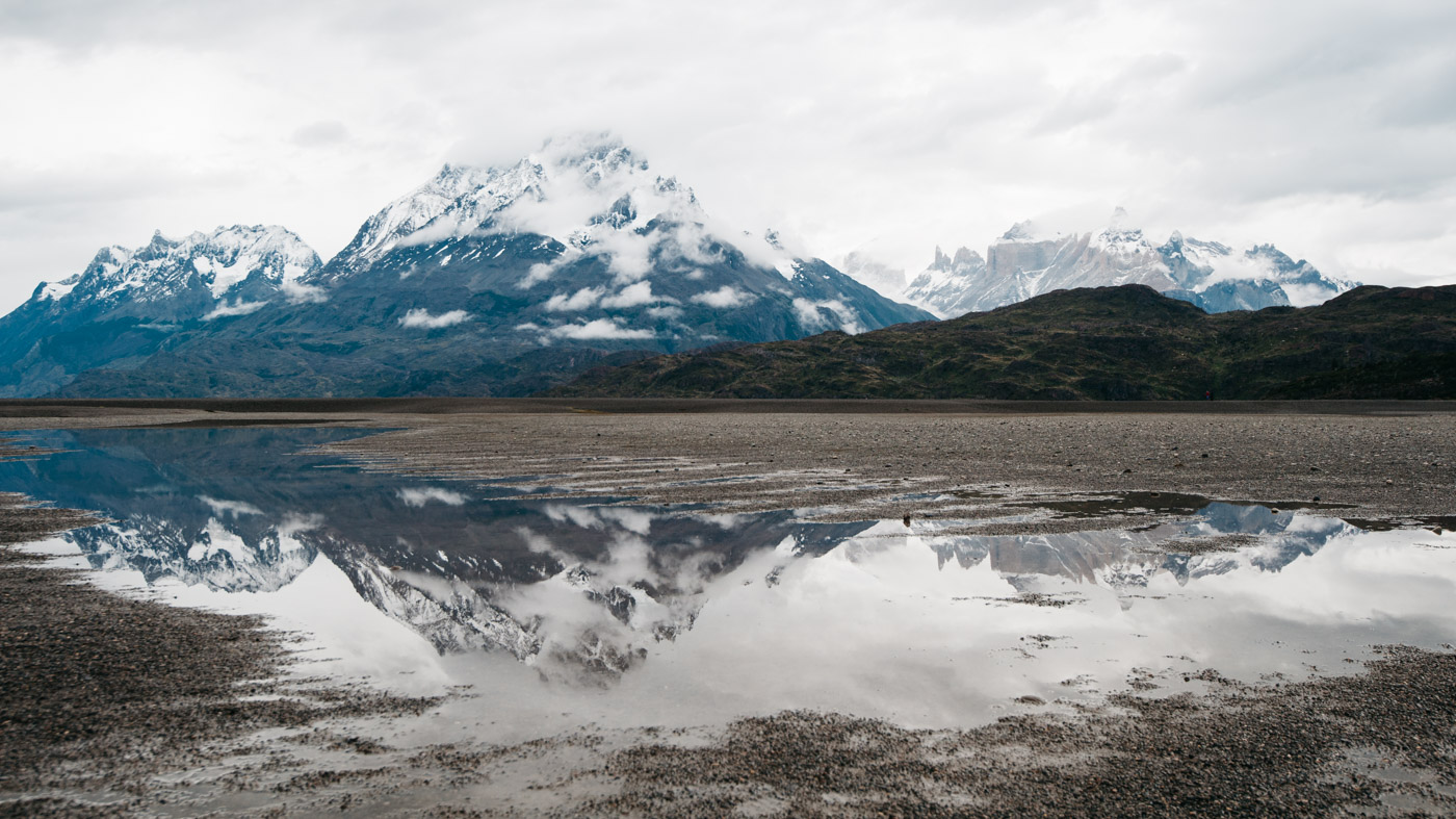 Reflection of the Torres del Paine on the south shore of Lago Grey